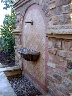 This narrow side yard  has enough room for a lovely water feature and gives a beautiful view from the indoors.