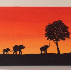 Elephants and giraffe walking along the African savanna. Painted red orange sunset on a 12x4 canvas.