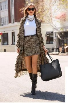 A sexy tweed skirt can elevate any look when styled with either a basic knit or a sensuous charm blouse Go for a match and pair with our tweed fringe trench. Trendy Outfits, Fashion Outfits, Womens Fashion, Fashion Tips, Fashion Websites, Cheap Fashion, Fashion 2018, Fashion Trends, Street Style Today