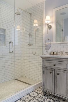 The master bathroom features subway tile, Carrara marble, and Moroccan-style cement tile on the floor. Bad Inspiration, Bathroom Inspiration, Upstairs Bathrooms, Master Bathroom, Small Bathrooms, Bathrooms Online, Bathroom Grey, Shower Bathroom, Marble Bathrooms