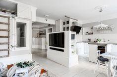 Un apartament nordic cu accente vintage și o surpriză în living