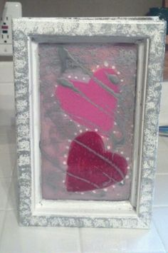 Hearts painted on an old window