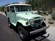Old school Toyota Land Cruiser.  I saw one of these the other day & fell in love!