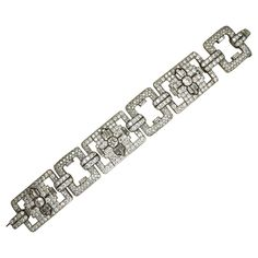 MAUBOUSSIN PARIS, Art Deco, Diamond and Platinum Bracelet | From a unique collection of vintage link bracelets at https://www.1stdibs.com/jewelry/bracelets/link-bracelets/