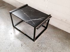 black marble coffee table with brass accents