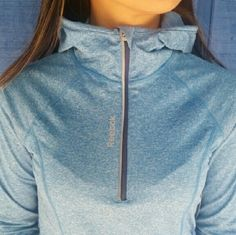 Reebok Running Jacket Heather Blue. Size: XS. Half-zip pullover with hood. Holes in the sleeve for thumbs. Brand new with tag. Never worn except to take pictures. Reebok Jackets & Coats