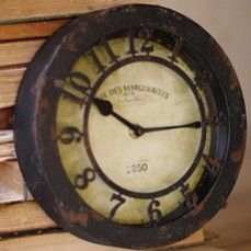 Iron Clock    $22.00 @ http://antiquefarmhouse.com/current-sale-events/quirky-accents.html