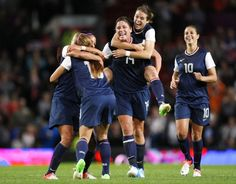 the us womens soccer national team celebrating after win over canada