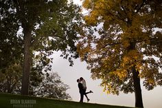 Photo by Brian Slawson Photography. Engagement photo. Outdoors, trees, romantic lift. #engagements #trees