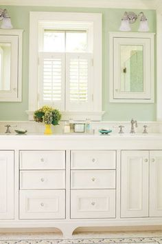 Choosing vintage-style fixtures gives this master bath a been-there-forever look, but a breezy color on the walls keeps it feeling light and fresh. | Photo: Tria Giovan | thisoldhouse.com