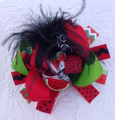 Huge big and wild summertime watermelon burst bow on an alligator clip