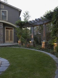 Stone columns and trellis - great way to add height and block the neighbors!  by Great Oaks Landscape Associates Inc.