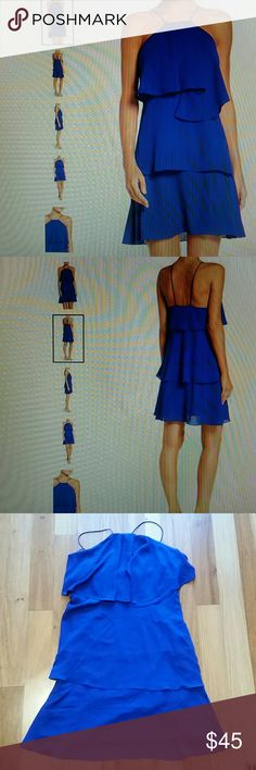 """CHELSEA28 TIERED A LINE DRESS BLUE SZ S ONCE WORN. IN SOME PLACES HAVE DEODORANT WHITE MARKS. ASYMMETRICAL TIERS FLUTTER WITH YOUR EVERY STEP IN THIS MODIFIED HALTER SLIPDRESS. 32"""" LENGTH ARMPIT TO ARMPIT 17"""" WAIST 15""""-APPROX ALL MEASUREMENTS ARE TAKING WITH THE GARMENT LYING FLAT.  SPAGHETTI STRAPS.LINED.100% POLYESTER. HAND WASH COLD. Chelsea28 Dresses Asymmetrical"""