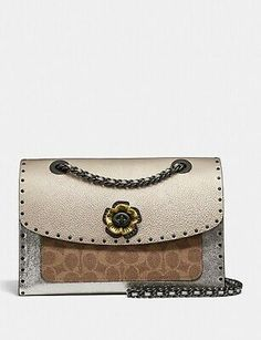 Coach Parker In Signature Canvas With Rivets And Snakeskin Detail Coach Purses, Coach Bags, Bag Jeans, Monogram Online, Gold Handbags, Pewter Metal, Coach Leather Cleaner, Pebbled Leather, Shoulder Strap