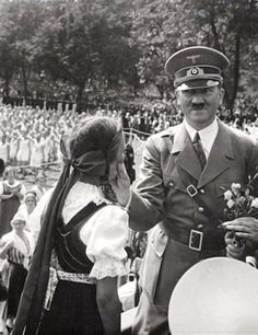 Germany. Adolf Hitler Giving A Little Girl A Cheek Squeezing, Mid-30's. Weird.