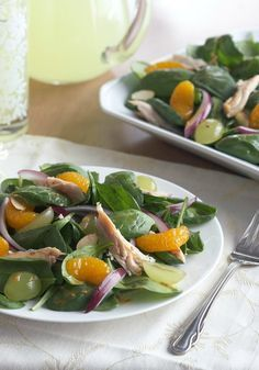 Mandarin Spinach Salad with Chicken -- Sweeten up your salad routine with mandarin oranges and grapes. Add some spinach and chicken for a healthy living recipe that's big on flavor. Almonds provide a fun crunch.