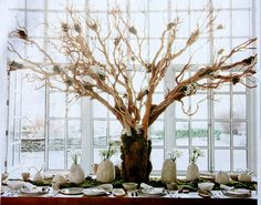"Hang blank notes guests pull off and write ""wedding wisdom"" on this. Centrepiece for gift table."