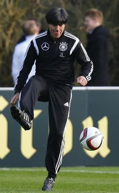 German national soccer coach Loew plays a ball during a training session in Frankfurt