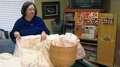 Volunteers make gowns for Angel babies who never make it home - - out of donated wedding gowns!