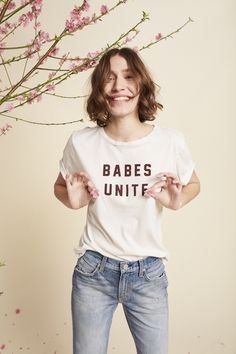 """BABES UNITE!  Our must-have tee! With 20% of the proceeds donated to Planned Parenthood,  this tee was made for us women as a reminder that we are stronger together!  Vintage white jersey with """"BABES UNITE"""" printed in faded black ink.  Carefully hand distressed edges and holes at th"""