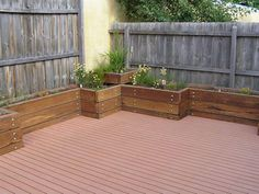 use raised garden beds to add plants to patios and decks