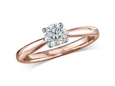 18ct rose gold set single stone diamond engagement ring, with a certificated brilliant cut, in a four claw setting. Perfect fit with a wedding ring.  A 0.55ct, Brilliant, D, Single stone diamond ring. You can reserve online and view in store at Michael Jones Jeweller, Banbury