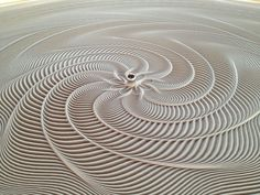 Bruce Shapiro (previously) has transformed the tools that create sculpture into the sculpture itself, using CNC machines to produce tables that trace beautiful patterns in thin layers of sand. Shapiro named this kinetic art project Sisyphus, an appropriate title as the metal balls that move thro