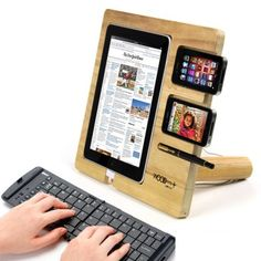 ipad wooden stand. This also makes me wonder: Given That a tablet costs about what a monitor used to cost way back when, how soon will it be before multi-tablet setups are the norm? It would make for some interesting gaming.