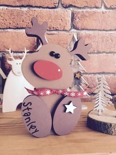 A Super cute Wooden Rudolph Reindeer Christmas Ornament. Made from high quality chunky MDF wood and finished in luxury paints. You can add a name to the foot of the reindeer if you wish making an Mdf Christmas Decorations, Christmas Wood, Outdoor Christmas, Christmas Time, Christmas Crafts, Christmas Ornaments, Reindeer Christmas, Reindeer Decorations, Wooden Reindeer