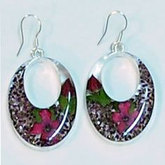 Real Flower Earrings, Oval. The flowers are real flowers grown without fertilizers or pesticides. Earrings are made through cottage industry in Taxco Mexico.  Margarito Santos and his brother started the business and with a small team of workers they grow the flowers and make the jewelry in their homes, encasing and preserving the flowers. Fair Trade!