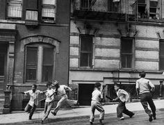 Young boys with play a street game in Spanish Harlem in January 1947.