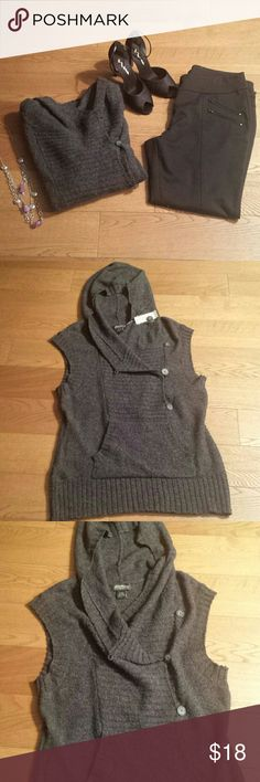 NEW Charcoal  Gray  Hoodie  Vest - Large BRAND NEW Eddid Bauer Hoodie Vest with front sweatshirt  type of pocket  in front.  3 front buttons to wear different ways with long  sleeve of some type under it. Machine washable. Eddie Bauer Sweaters