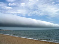A Roll Cloud Over Uruguay Credit & Licence: Daniela Mirner Eberl  A type of arcus cloud called a roll cloud. These rare long clouds may form near advancing cold fronts. In particular, a downdraft from an advancing storm front can cause moist warm air to rise, cool below its dew point, and so form a cloud. When this happens uniformly along an extended front, a roll cloud may form. Roll clouds may actually have air circulating along the long horizontal axis of the cloud. January 2009