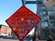 NYC. Lower East Side. If this traffic sign doesn't make you want to go visit Ludlow St., then nothing will...