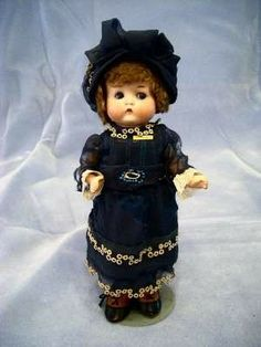 """German 9-inch Armand Marseille """"Just Me"""" doll with closed mouth and bisque head."""