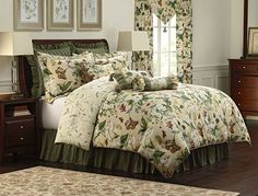 """From the archives of Colonial Williamsburg, these beautiful garden flowers, magnolias, dogwoods and butterflies on the face of this comforter will enhance any bedroom. This printed jacquard pattern is done in shades of green and ivory, with accents of red, blue and yellow. Set includes comforter, shams, and bedskirt. The shams are flanged with cord and bedskirt is ruffled with 15"""" drop. Window treatments and decorative pillows sold separately. 100% Cotton. Dry Clean Only."""