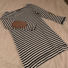 Elbow Patch Striped Tunic This is a black and white fitted striped tunic with suede camel elbow patches. Sleeves are 3/4 sleeves. Happening In The Present  Tops Tunics