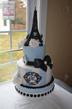 Paris-themed cake.  The Eiffel Tower was made from royal icing.