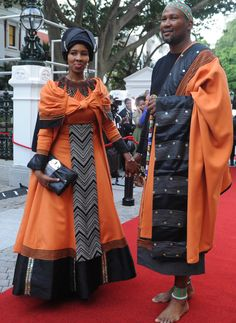 "Chief Zwelivelile ""Mandla"" Mandela walks on red carpet with his wife.(Matiba Mutheiwana)"