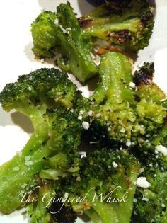 Roasted Broccoli - Preheat oven to 425.  Cut 2 large bunches of broccoli into florets  place in a bowl.  Add S  P, 4 thinly sliced cloves garlic, drizzle with olive oil  toss to coat.  Line a cookie sheet with aluminum foil, pour on broccoli  roast for 20-25 minutes til broccoli is tender and a bit brown at edges.  Remove the pan from the oven, sprinkle on 1 T parmesan cheese, a good squeeze of lemon and 1 t. lemon zest and a little more olive oil on top, toss and enjoy.