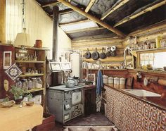Love the old stove, cast iron, cabinet...