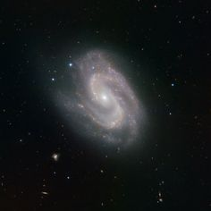 "In this image of galaxy NGC 157, the spiral arms appear to form a giant ""S"". The HAWK-I instrument (High-Acuity Wide-field K-band Imager) on ESO's Very Large Telescope (VLT) in Chile produced this picture of the galaxy. NCG 157 lies distantly in the constellation of Cetus (the Sea Monster)."