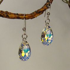 Stunning crystal pendants light up the room with their breathtaking beauty and precision-cut facets that create showers of light reflections. These colorful 5/8 inch drops are hung on .925 sterling silver french hook earwires.