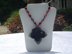 Black and red floral necklace