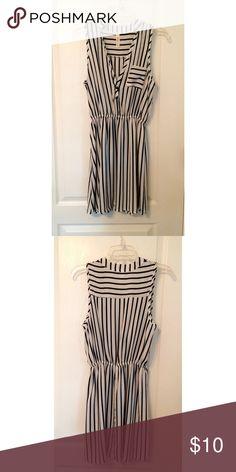 """Lightweight Black and White Striped Mini Dress Lightweight black and white v-neck button down striped mini dress. Like new. Only worn once. Approximately 2' 9"""" long. Dresses Mini"""