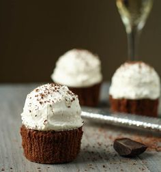 Chocolate cupcakes with a ganache center and Italian meringue buttercream frosting