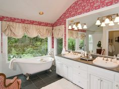 Master Bathroom with Clawfoot Tub, like this a lot but not that wallpaper.