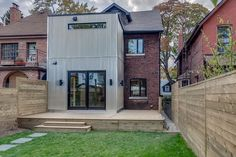 Entirely rebuilt addition clad in corrugated steel Toronto Houses, Old Bricks, Garage Doors, Old Things, Real Estate, Street, Outdoor Decor, Modern, Home Decor