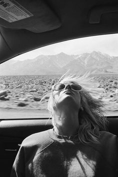 black and white photography | sunglasses car driving