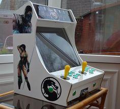 Mini borne d'arcade avec 16 systèmes et 3735 jeux vidéos intégrés | w3sh.com